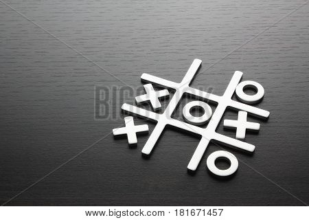 Tic Tac Toe Game on Wooden Background