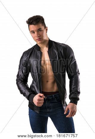 Handsome young muscleman with leather jacket on naked torso, isolated on white background in studio shot