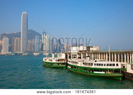 HONG KONG - APRIL 2: Ferries docked on Kowloon pier on April 2, 2017 in Hong Kong, China. Hong Kong ferry is in operation for more than 120 years and is one of main attractions of the city.