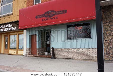 KALKASKA, MICHIGAN / UNITED STATES - NOVEMBER 27, 2016: One may eat pizza and drink beer at the Kal-Ho Lounge on Cedar Street in downtown Kalkaska.