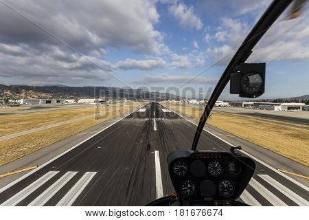 Burbank, California, USA - April 12, 2017:  Runway approach with afternoon clouds in Southern California.