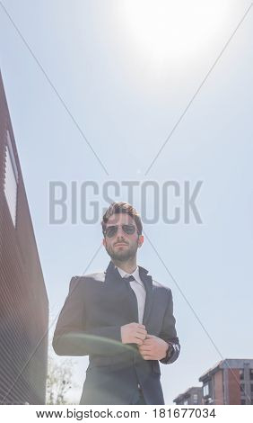 Low Angle View, One Young Man Buttoning Suit, Sky Day Sun