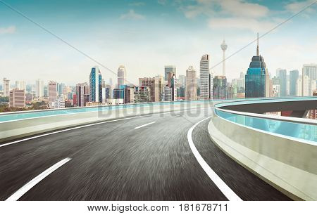 Highway overpass motion blur effect with modern city skyline background .