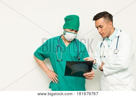 Asian Male Medical Doctors With Xray Film On White Background