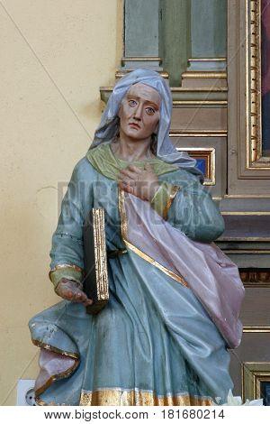 SISLJAVIC, CROATIA - AUGUST 23: Saint Ann statue at the altar in the Parish Church of Saint Joseph in Sisljavic, Croatia on August 23, 2011.