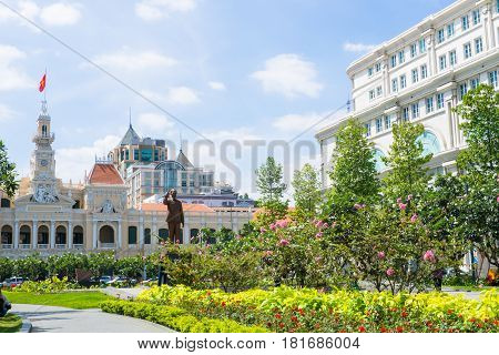 SAIGON, VIETNAM - MARCH 26, 2017: Ho Chi Minh City People's Committee Building city Hall was built in 1902-1908 in a French colonial style displays Uncle standing and greeting high 7.2 meters