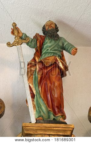 POKUPSKO, CROATIA - JULY 10: Saint Paul statue at the altar in the Parish Church of Assumption of the Virgin Mary in Pokupsko, Croatia on July 21, 2011.
