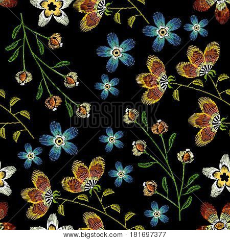 Cornflowers embroidery seamless pattern. Beautiful spring flowers on black background. Classical embroidery fashionable template for design of clothes