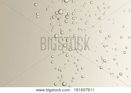 Many fizz bubbles soars over a light brown surface.