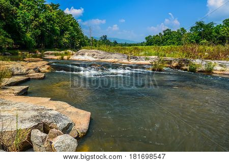 Waterway from waterfalls in natural public park in Thailand