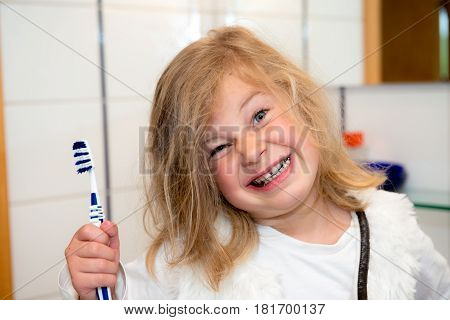 Little Funny Girl With Retainer And Toothbrush