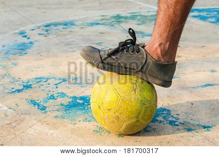 sport, football and people - soccer player playing with ball on field