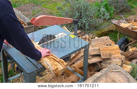 Man Making Firewood With Buzz Saw