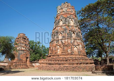 Ancient prangs of Buddhist temple Wat Mahathat on a sunny day. Ayutthaya, Thailand