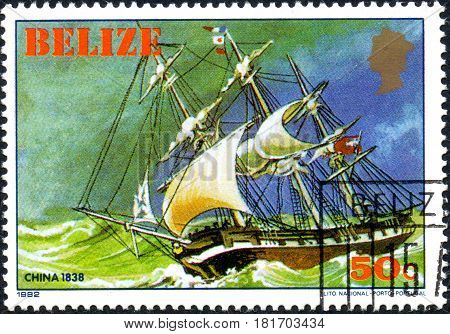 UKRAINE - CIRCA 2017: A postage stamp printed in Belize shows sailing ship China 1838 from the series Historic ships circa 1982