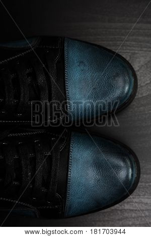 Fashion male shoes on a wooden background