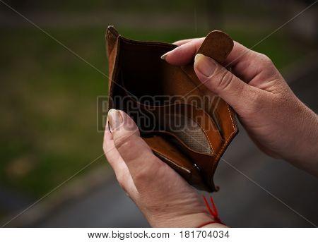 closeup human hands holding empty wallet purse