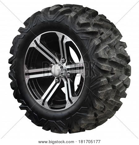 Wheel with high tread for ATV isolated on white background.