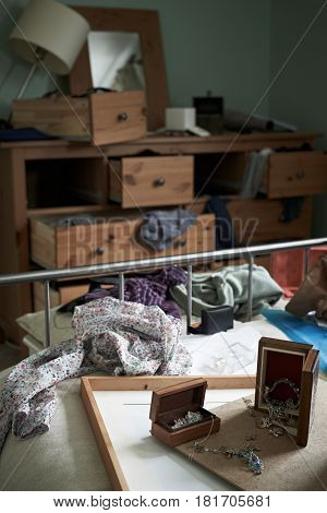 View Of Empty Bedroom Ransacked During Burglary