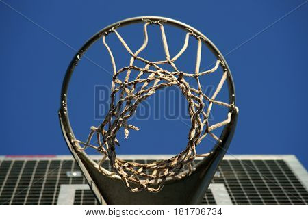 Outdoor photography of a old basketball hoop