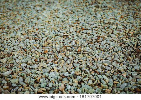many small grey pebble rock background texture