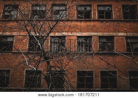Broken glass window in the old abandoned industrial building