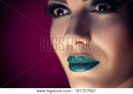 Beauty Model Face with Turquoise Makeup closeup