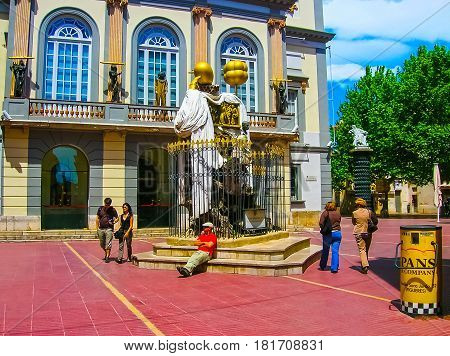Figueres, Spain - May 07, 2007: The people walking near Monument to the Catalan philosopher Francesc Puzholsu in front of the theater and the museum of Salvador Dali in Figueres, Spain on May 07, 2007