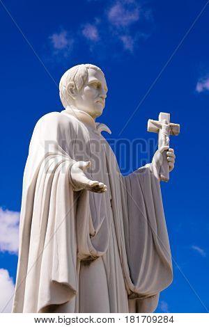 Guam island,USA - May 25, 2016:Statue of Missionary Saint Bitoresu at Dulce Nombre de Maria Cathedral Basilica of Guam Island,USA