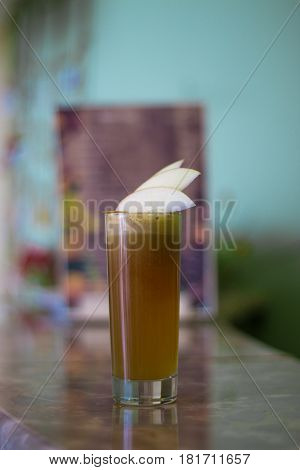 Freshly squeezed apple juice on the table