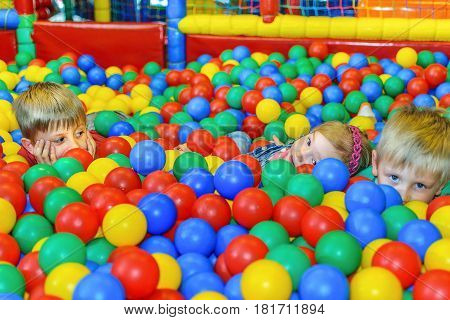 Children playing in a ball pool at the party.