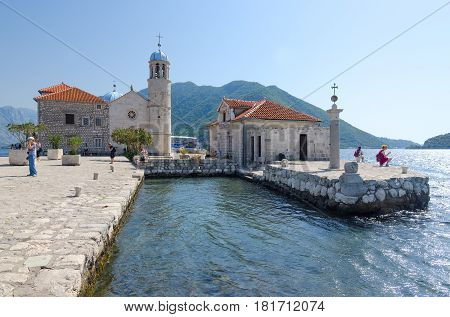 PERAST MONTENEGRO - SEPTEMBER 16 2015: Unknown people visit Island of Virgin on Reef (Gospa od Skrpela Island) Montenegro