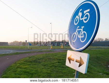 blue traffic sign for bicycles and mopeds in both directions