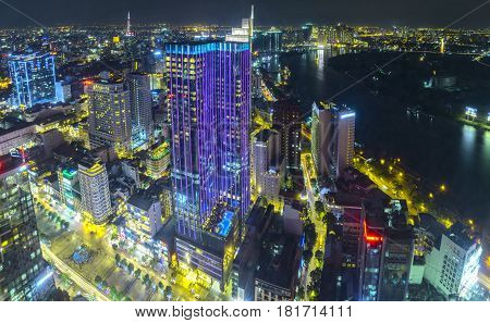 Ho Chi Minh City, Vietnam - April 11, 2017: Aerial night view of colorful and vibrant cityscape of downtown with traffic light trails Skyline by night in Ho Chi Minh city, Vietnam