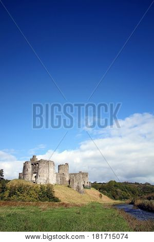 Kidwelly, Wales, UK, September 25, 2015 : Kidwelly Castle  by the River Gwendraeth is a ruin of a 13th century medieval castle and a popular tourist attraction