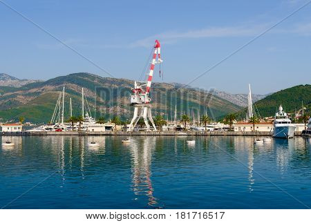Load-lifting crane and ships off coast of Tivat Bay Tivat Montenegro