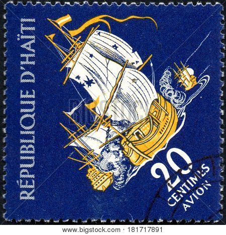 UKRAINE - CIRCA 2017: A postage stamp printed in Haiti shows sailing ship Privateer in Battle from the series Tourism. History of Tortuga Island circa 1961