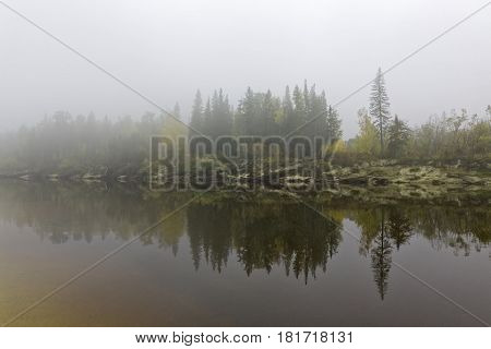 Yugra a misty morning on the bank of the taiga river Bolshoy Yugan