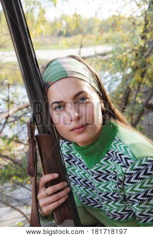 Portrait of a female hunter with a gun in Siberia