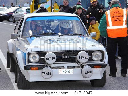 Castelvecchio di Rocca Barbena Italy - March 02 2014 - Eighth rally Historical Of Imperiesi Valli: The Ford Escort RS crew Gregorini-Aivano at the start of the special stage called Melogno timed speed.