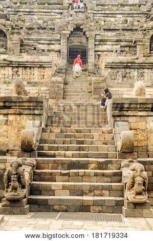 Borobudur, Indonesia - 31 January 2013: people walking down the stairs at the temple of Borobudur in the island of Java Indonesia