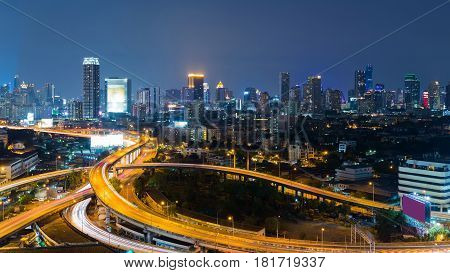 Aearial view City business downtown light and highway interchanged at twilight cityscape background