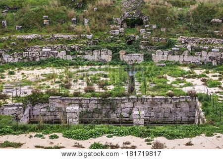 Arena of amphitheatre from Roman era in Neapolis Archaeological Park in Syracuse Sicily Island of Italy