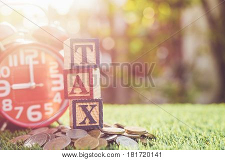 Tax Write In Color Alphabet Wood Box On Stack Of Thai Baht Coin And Red Alarm Clock With Right Free