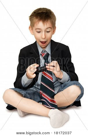 Surprised Boy With Cell Phone