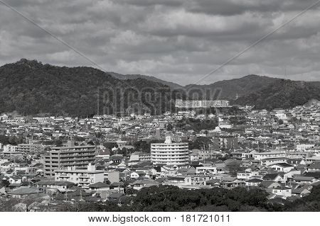 Black and White Himeji residence city downtown with mountain background from Himeji castle in Hyogo Kansai Japan