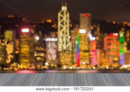 Opening wooden floor Night blurred bokeh light Hong Kong city business downtown over Victoria Bay night view