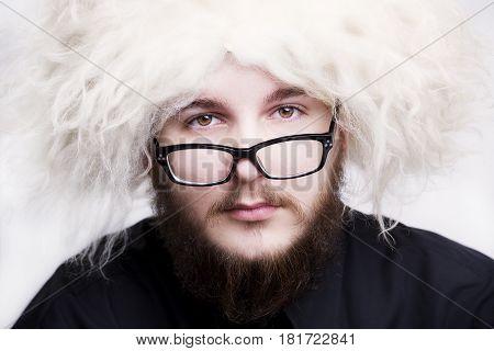 Portrait Of Beardman Wearing Traditional Georgian Shepherd's Hat And Eyeglasses