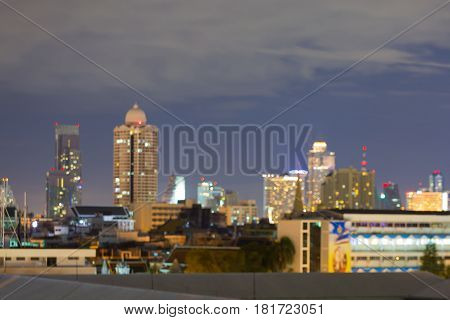 Office building blurred bokeh light night view abstract background