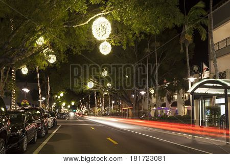 Street in the city of Naples illuminated at night. Florida United States